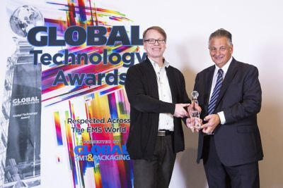 Photo of mark currie accepting global technology award for henkel ae at smt international conference recognizing bergquist peelable 1500rw gap filler liquid interface material as best new innovation