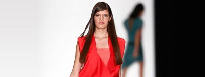 Model in red dress and long brown hair