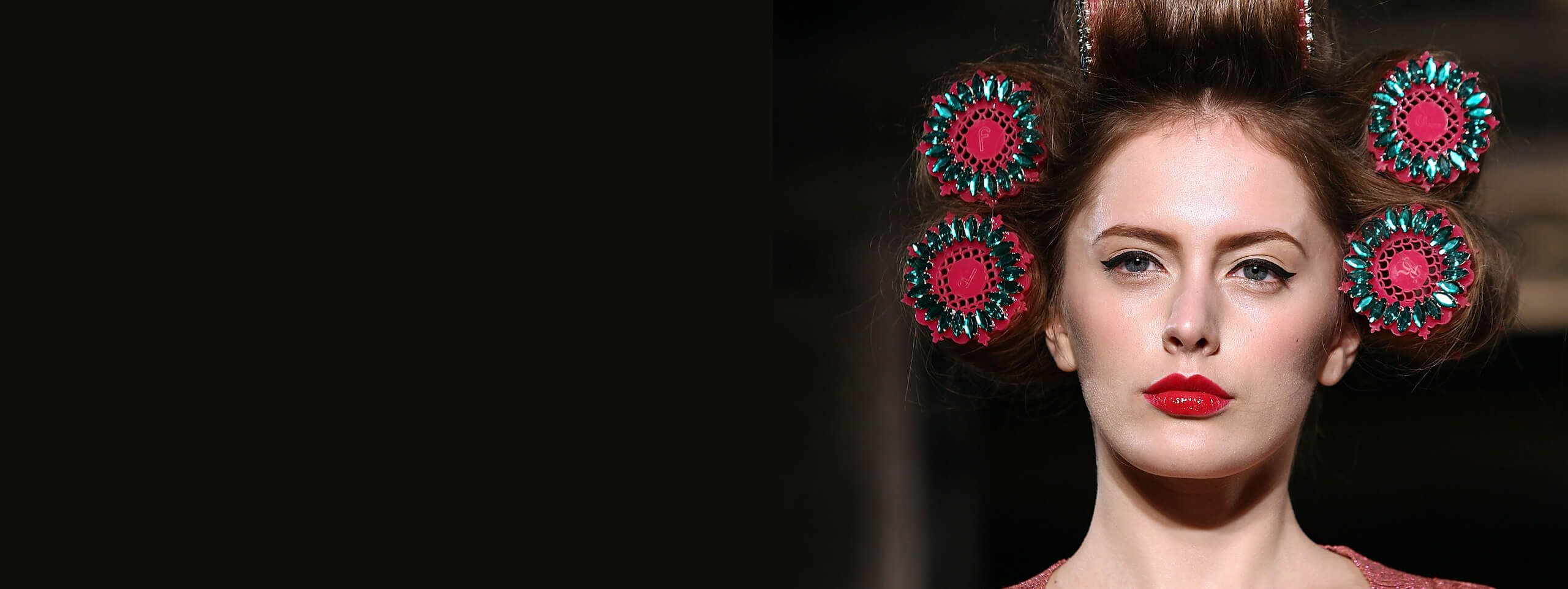 Model wearing hair rollers for a trendy womens hairstyle