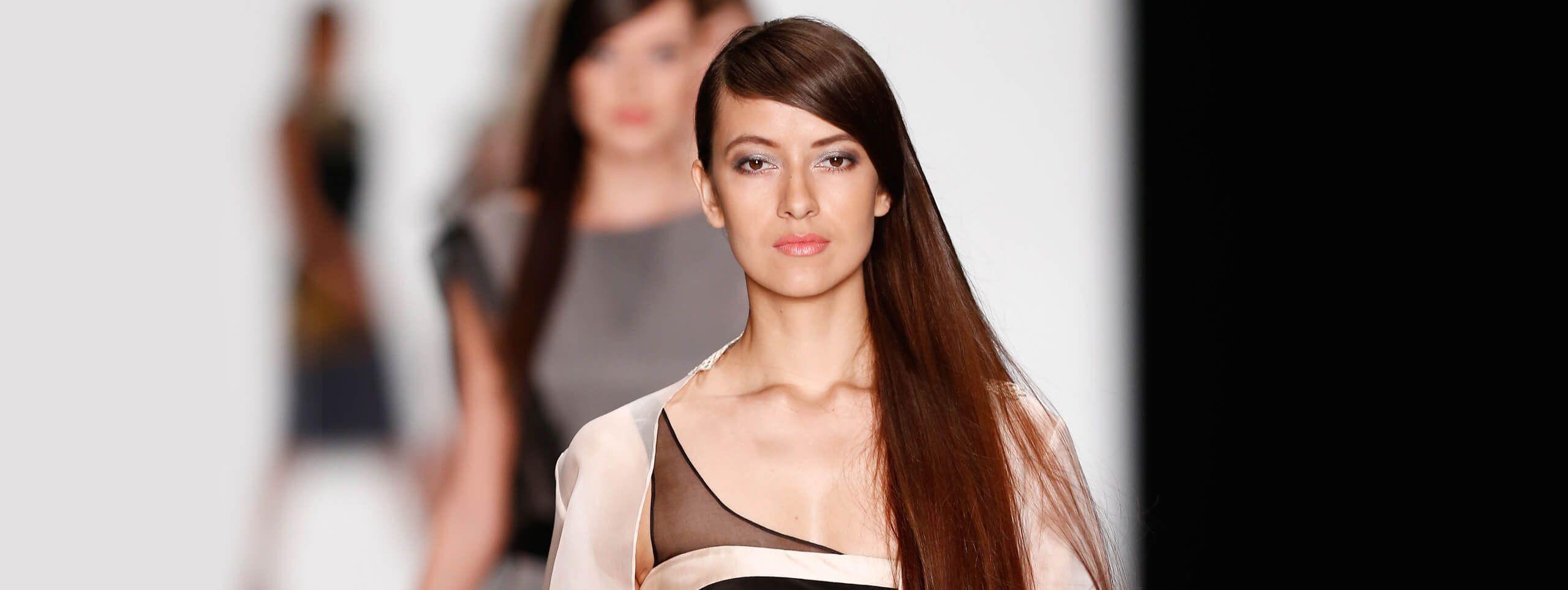 Model wears sleek straight hairstyle