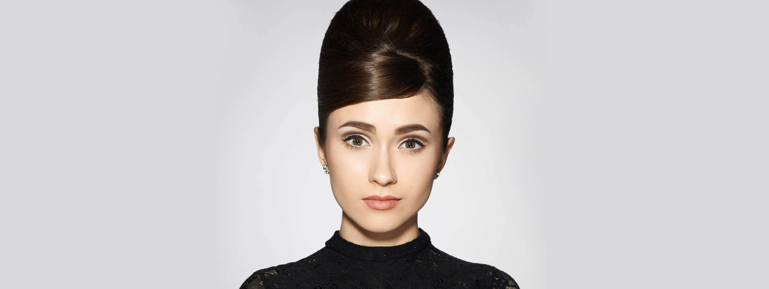 Model with her hair down up in a beehive hairstyle