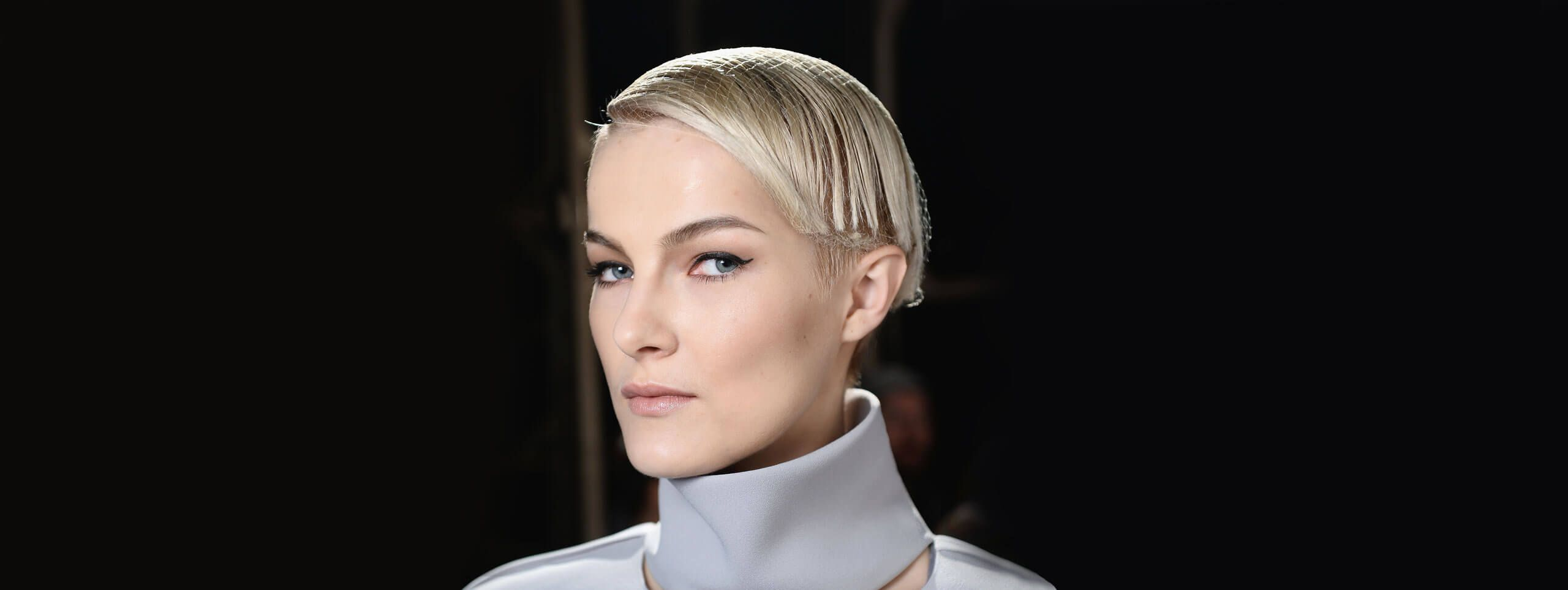 Model with short hairstyle wearing a hair net