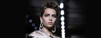 model on runway black background