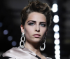 Model with short wavy and tousled hairstyle