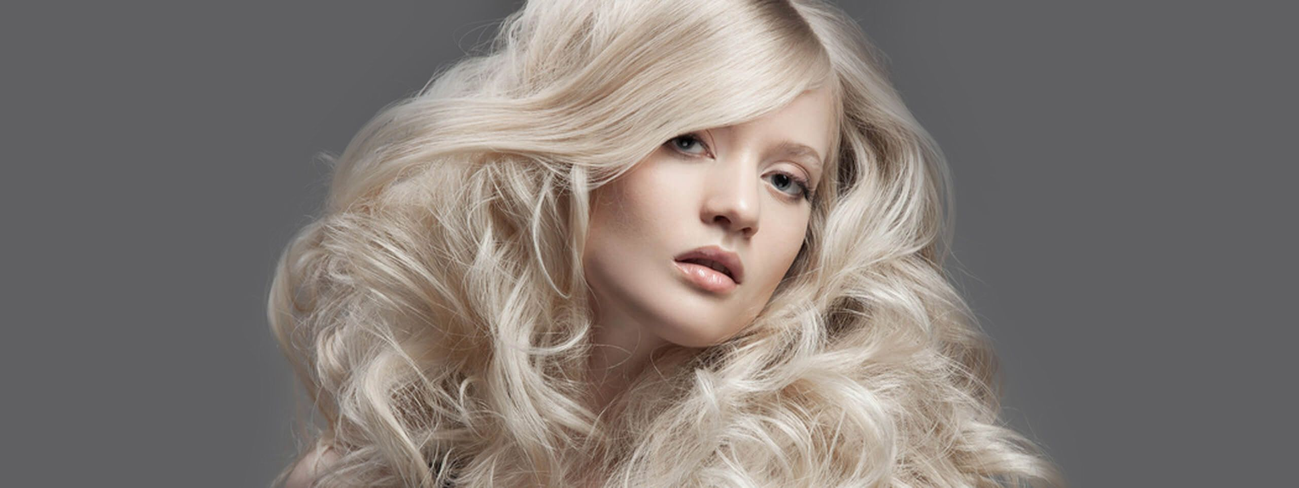Model with voluminous blonde hairstyle