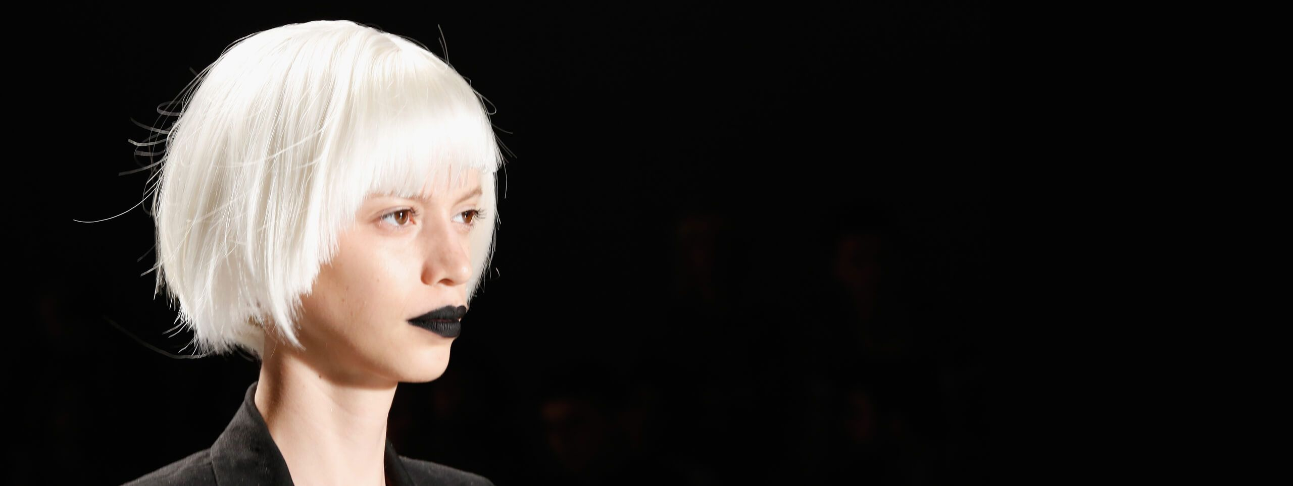 Model with white hair in short bob hairstyle with bangs
