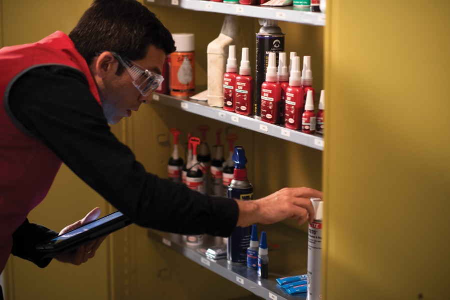 man looking at loctite products on a shelf