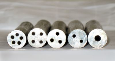 Magnified photo of a variety of cored solder wires side by side cross section view