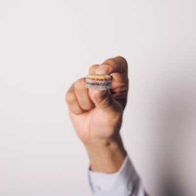 KOPF+ hand holding candy