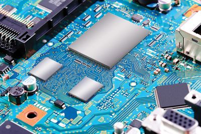 Photo of blue electronic circuit board graphically enhanced with package level EMI shielding on three components base image is shutterstock ID 333379685