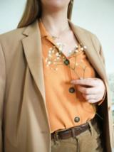 Nur eine von Nicoles zahlreichen wunderhübschen Farbkombinationen: Pastellorange und Hellbraun