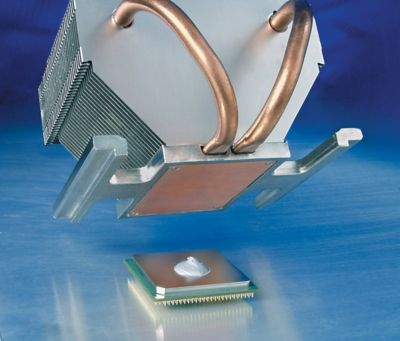 Photo of application of bergquist phase change thermal interface material to chip surface represents alternative to thermal grease