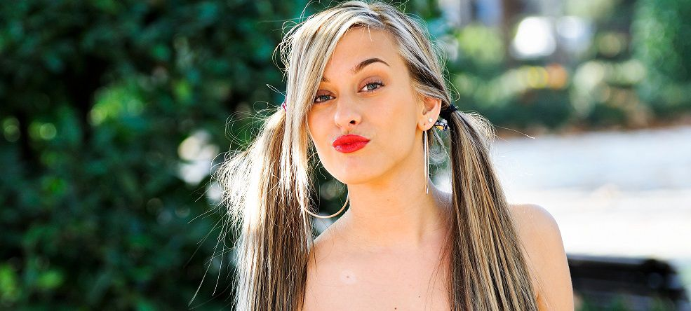 Woman with long pigtails