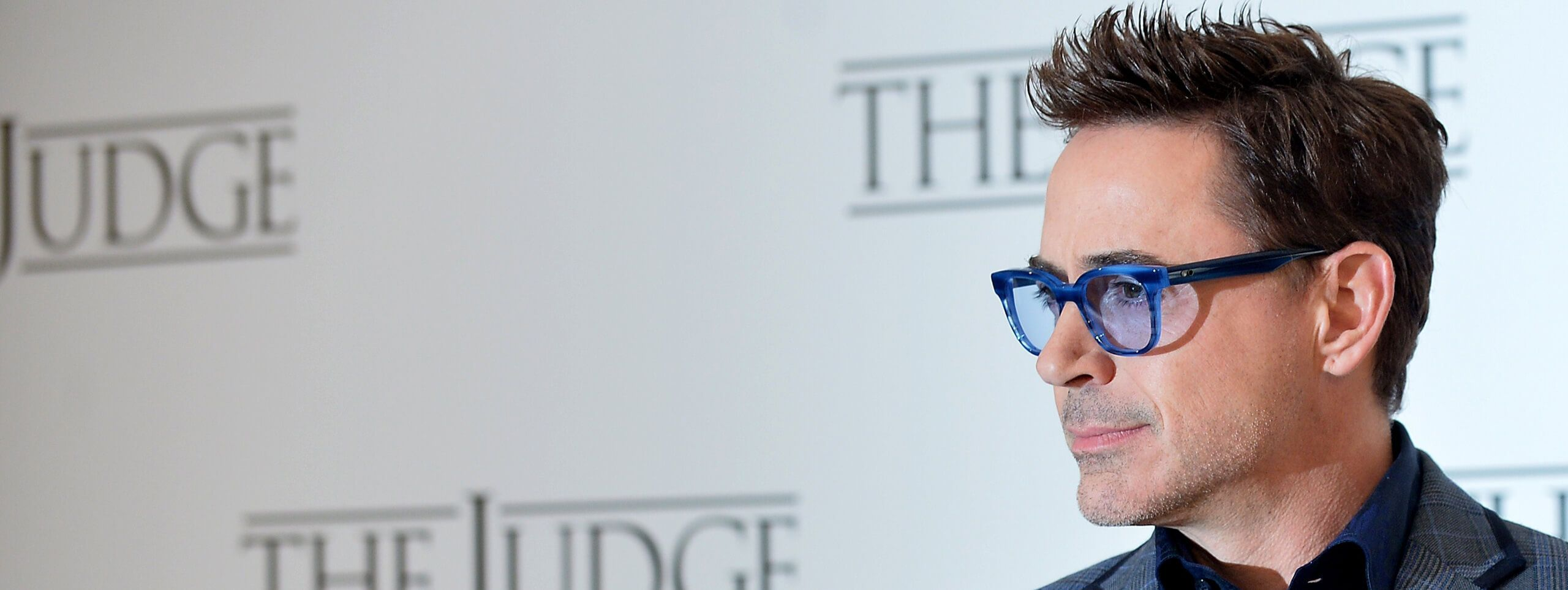 Robert Downy Jr wearing glasses and a fohawk