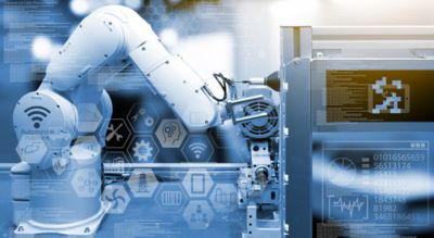 Photo of wireless robotic arm in a smart factory embellished with blue overtones and digital data  on the foreground of the image represents adhesive solutions for industrial automation shutterstock ID 495716128