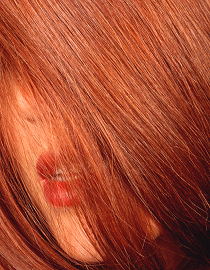 Woman with red hair covering her face