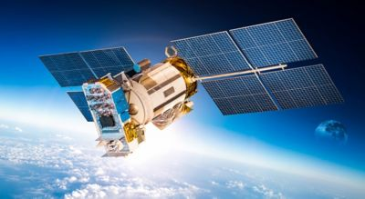 Shutterstock photo of space satellite orbiting a blue earth with white clouds