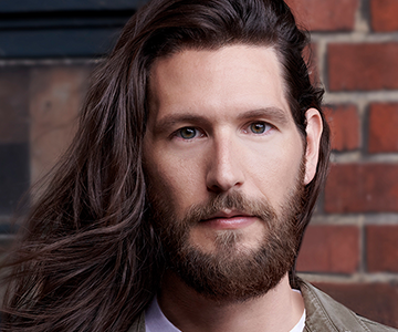 Man with long brunette hair and beard