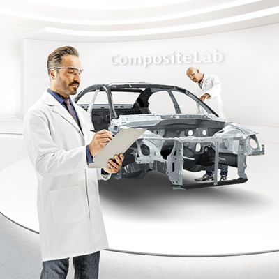 Scientists examine a car body in the Henkel composite lab