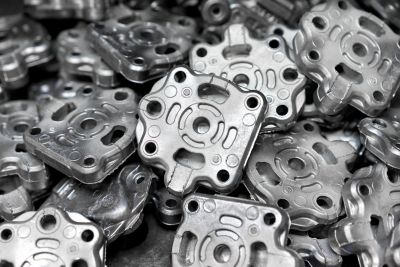 Pile of aluminum automotive parts, casting process in the automotive industry factory
