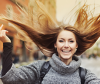Girl flipping her healthy hair in the air