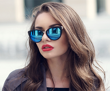Woman with dyed brunette hair and sunglasses