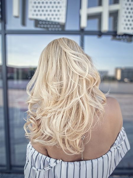 Back view of woman with dyed light blonde hair