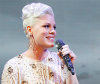 Singer with white hair in an elegant updo hairstyle