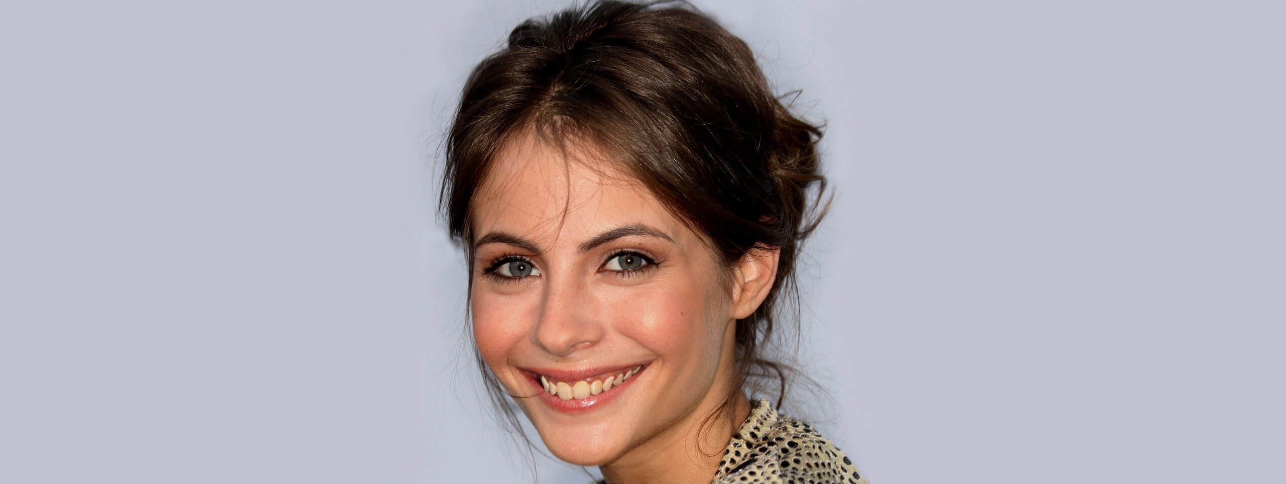 Smiling woman with an updo hairstyle