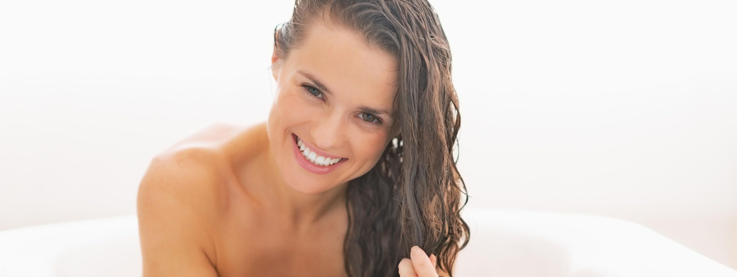 Smiling woman with wet hairstyle