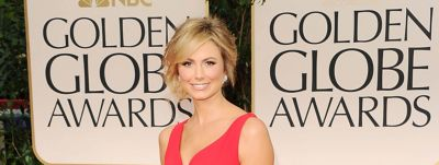 Stacey Keibler wears an elegant updo hairstyle with side fringe