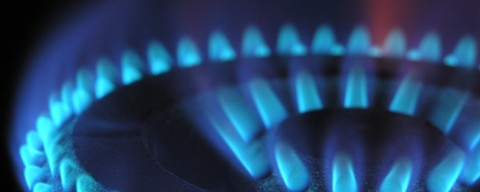 Blue flames from a gas stove top