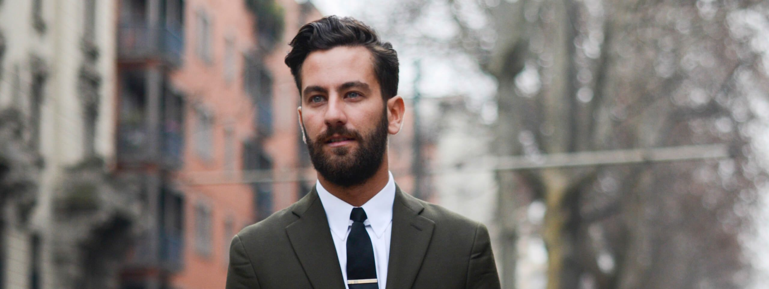 Suited man with a beard and short hairstyle