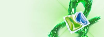 Kapsułka Persil na zielonym tle