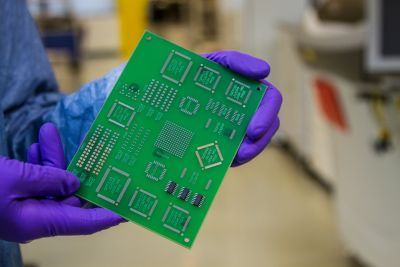 Photo of a brighter green printed circuit board with soldered components