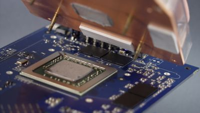 Photo of bergquist thermally conductive grease applied to metal electronic component on a blue printed circuit board