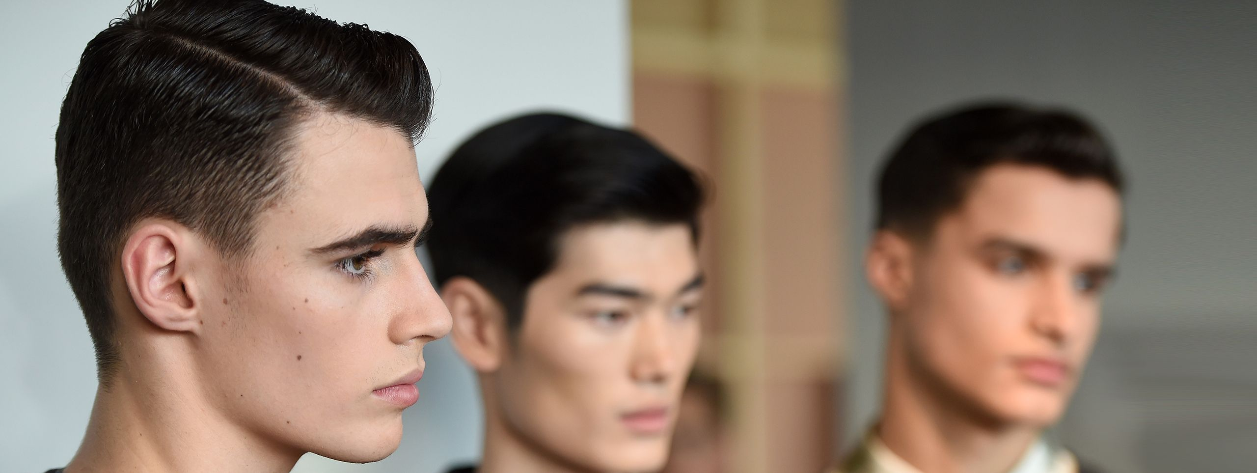 Three male models with faded hairstyles