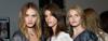 Three models with long wavy bohemian hairstyles