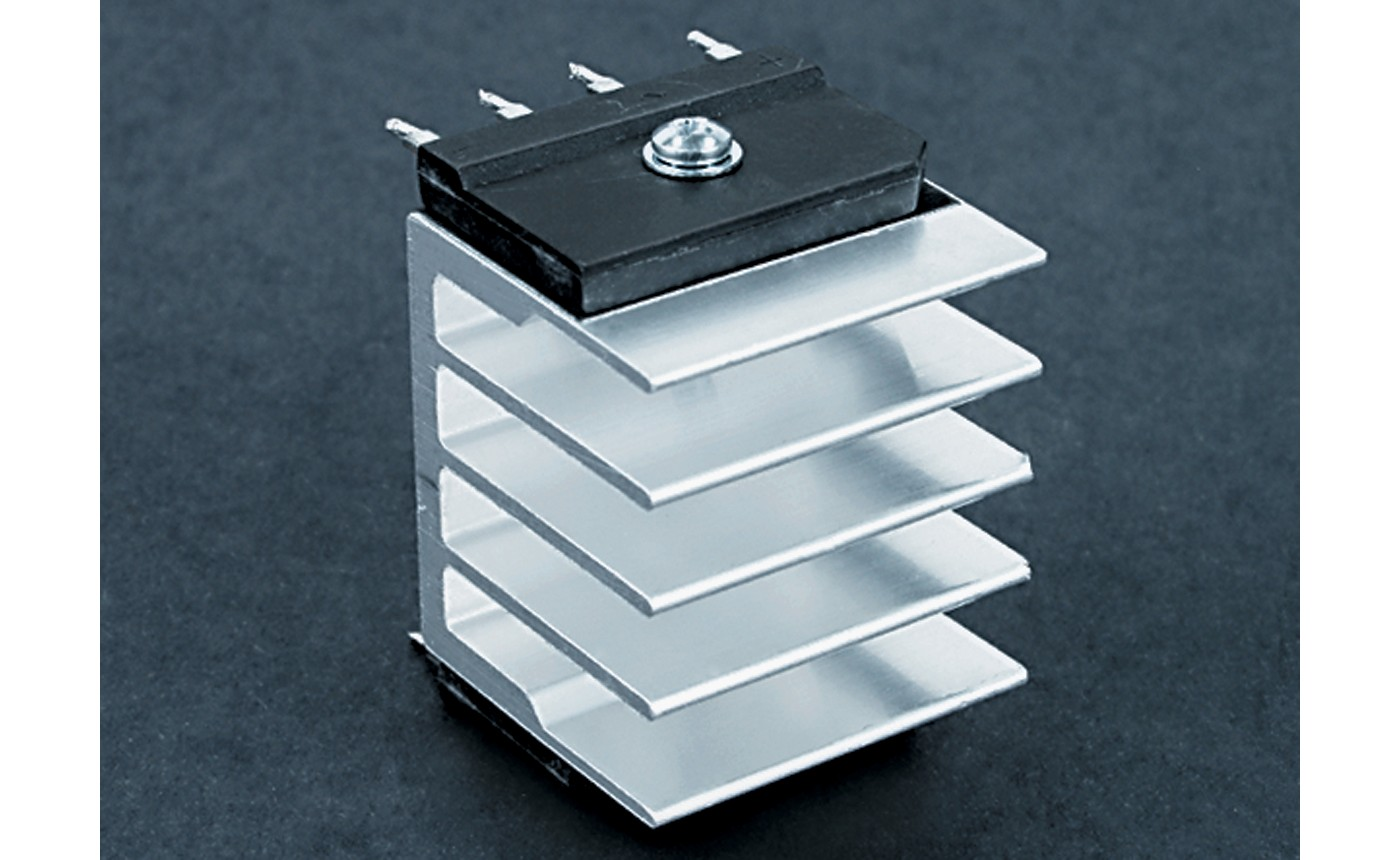 Photo of high power four lead transistor on a metal heatsink with bergquist q pad ii thermal interface material a direct replacement for silicon grease