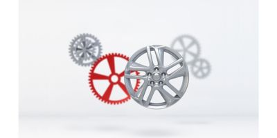 Illustration of a vehicle rim with four floating metal gears