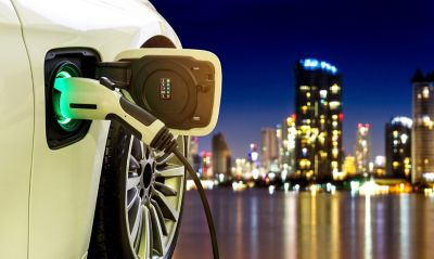 Electric vehicle charges in the city at night