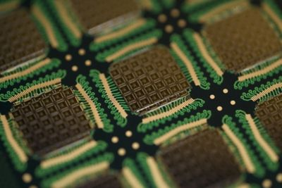 Closeup photo of stacked semiconductors wirebonded onto a laminate pcb using conductive die attach adhesive