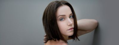 Young woman with shorter brown hair