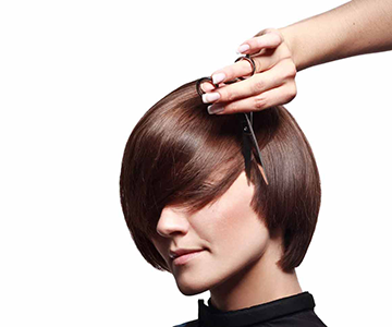 Woman cuts hair into short bob hairstyle