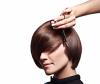 Woman cuts hair into short bob hairstyle