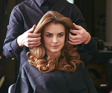 woman getting a new hairstyle at the salon