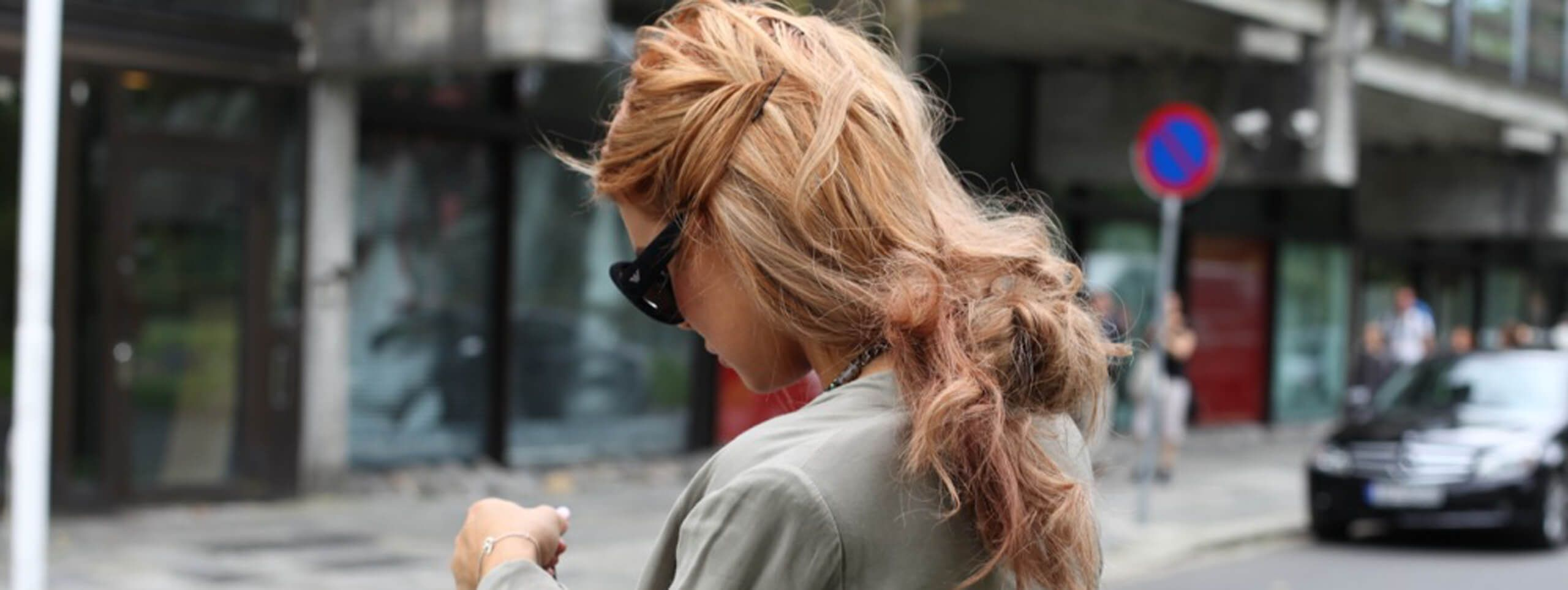 Woman in the street with messy and undone hairstyle