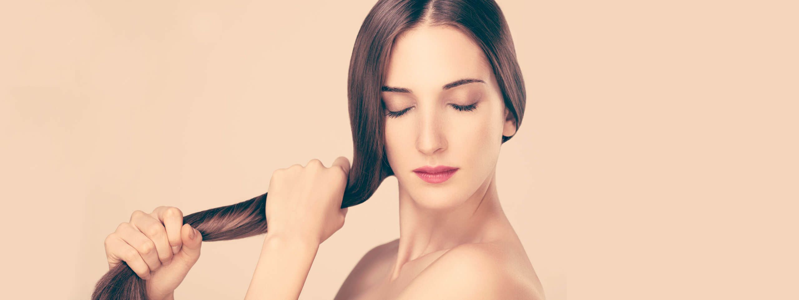 Woman styles hair with styling products