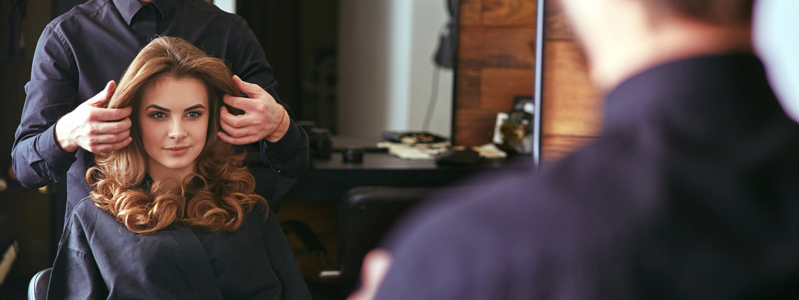 Woman visiting hair salon for new trendy hairstyle