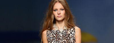 woman-wearing-leopard-print-blouse-wcms-us